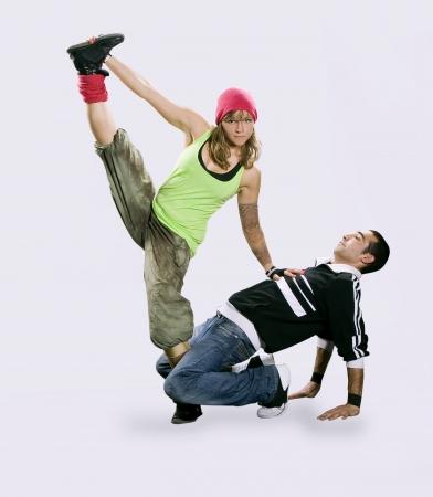 stunt: Teenagers dancing breakdance in action