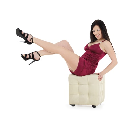 Portrait of beautiful young woman sitting on chair