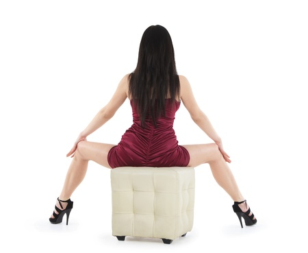 backview of sitting sexy woman in red dress on the chair Stock Photo - 13018416