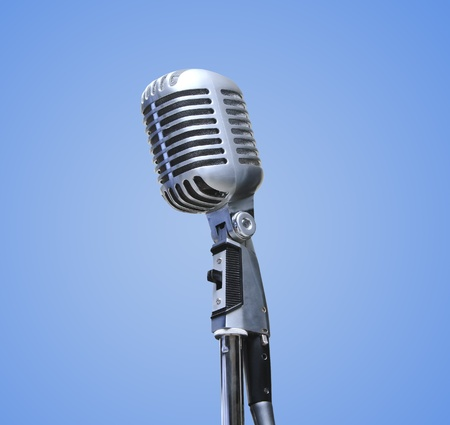 Vintage Microphone over blue background photo