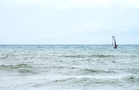 Kiteboarder enjoy surfing in the sea photo