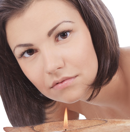 Young woman looking to the candle photo