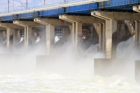 Reset of water at hydroelectric power station on the river photo