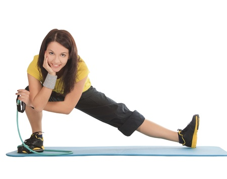 Attractive young female with fitness expander in stretching photo