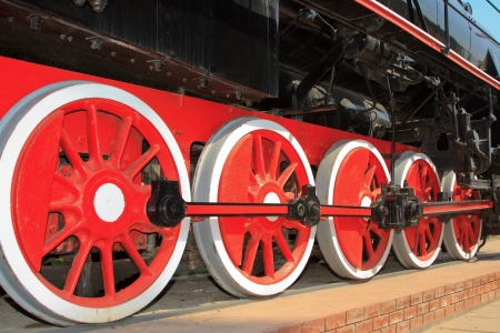 Red wheels of the old express steam train photo