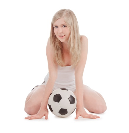 teenager sitting on floor with soccer ball over white photo