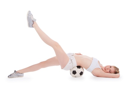 teenager lying on the floor with soccer ball over white photo