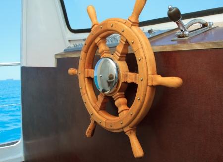 wheelhouse: old ship helm in the wheelhouse Stock Photo