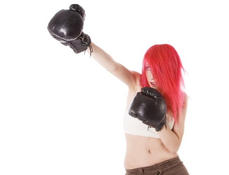 Red-hair girl kick boxer kicked in anger shouting photo
