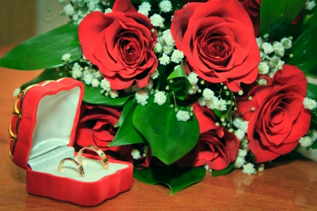 Wedding Ring and Red Rose photo