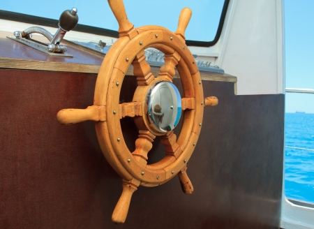 old ship helm in the wheelhouse Stock Photo - 17260403
