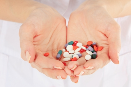 Close-up of doctor holding a pills in the hands photo