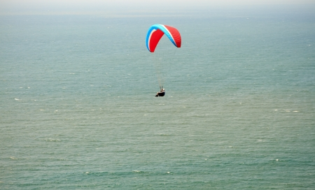 Paraplane flight. Paraplane flight over the sea photo