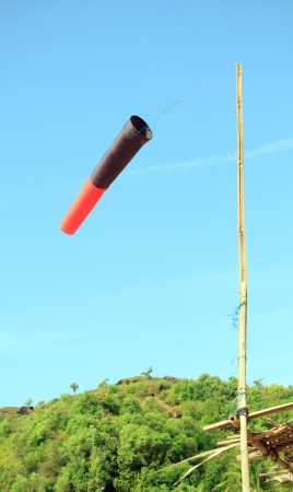 Old wind sock in jungle show direction of wind