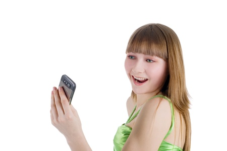 portrait of blonde girl with cellphone on white Stock Photo - 21775730