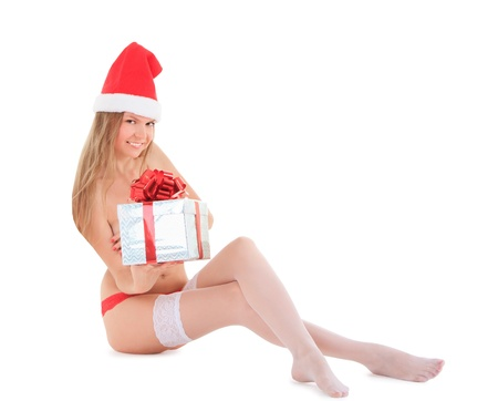 Beautiful nude santa woman with gift photo
