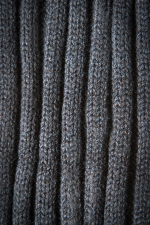Knitted Black Wool Pattern for background close up photo