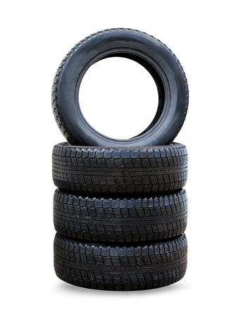 Stack of four wheel new black winter tyres for car photo