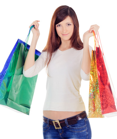 young female with colour shopping bags over white photo