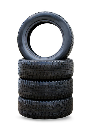 Stack of four wheel new black winter tyres for car Imagens