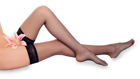 Lovely female long legs in black stockings photo