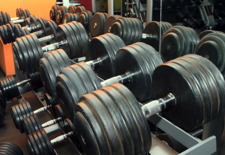 heavy weight: Dumb bells lined up in a fitness studio. Shot focus Stock Photo