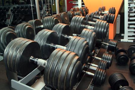 dumb bells: Dumb bells lined up in a fitness studio. Shot focus Stock Photo