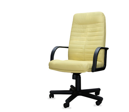 The office chair from yellow leather. Isolated photo
