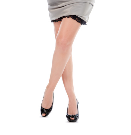 Beautiful womans legs in black shoes photo