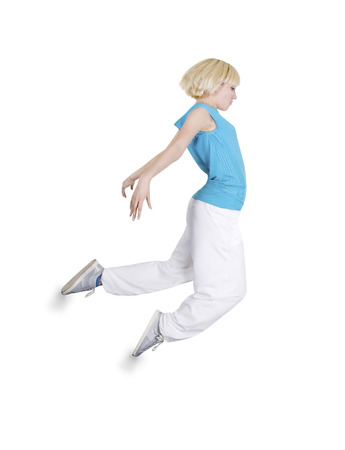 Teenage girl dancing hip-hop over white background photo
