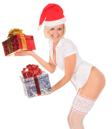 Beautiful christmas woman in santa hat and white stockings with gift box
