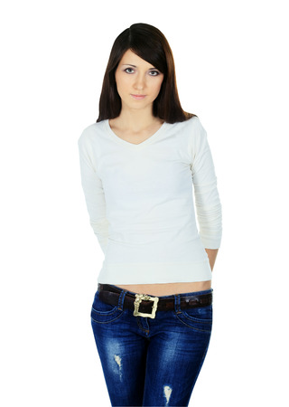 young woman in jeans and blouse posing on white background photo