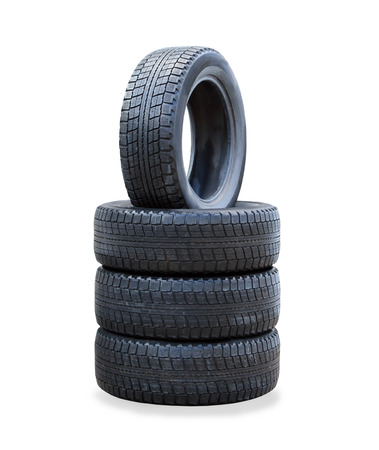 tread pattern: The stack of four winter new tires over white