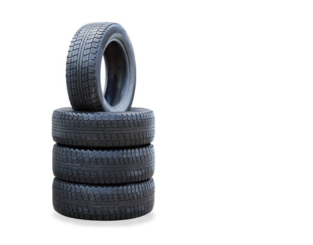 The stack of four winter new tires over white photo