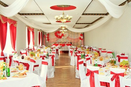 wedding reception: banquet hall or other function facility set for fine dining