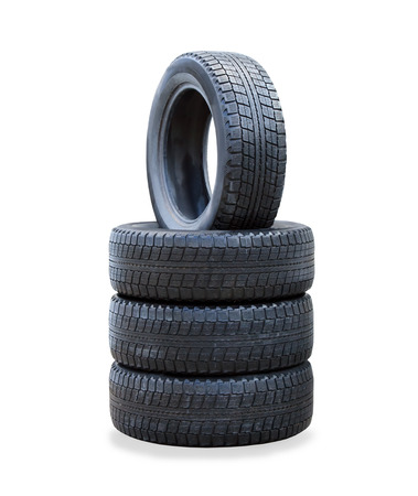 winter tires: The stack of four winter new tires over white