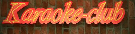 karaoke bar: Red and yellow sign board of karaoke club