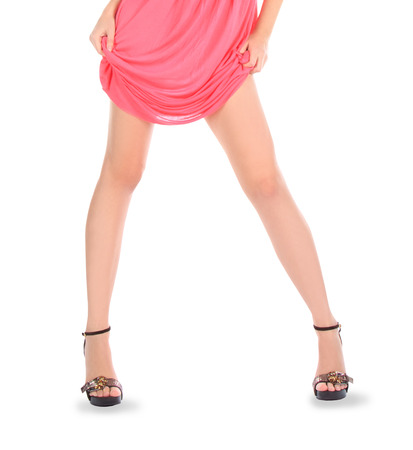 Young teen woman wearing a pink dress posing over white photo