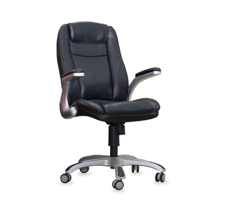 The office chair from black leather. Isolated photo