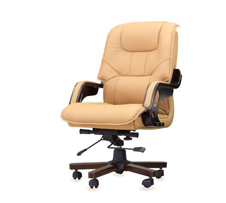 The office chair from beige leather. Isolated Stock Photo