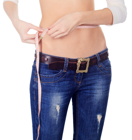 woman measuring: Woman measuring her waist over white