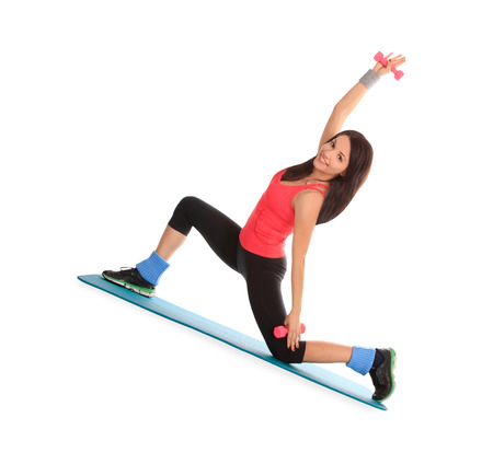expander: Attractive young female with fitness dumbbells in stretching