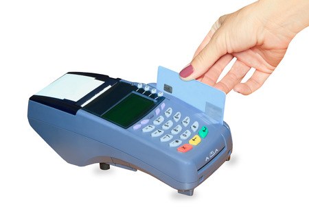 over the counter: Hand swiping generic credit card on an over counter POS terminal