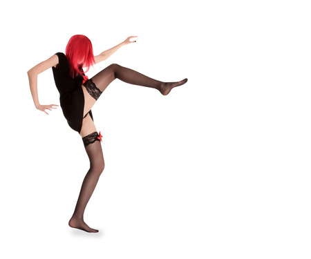 black stockings: picture of red hair woman in black stockings posing Stock Photo