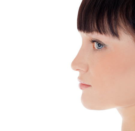Profile of pretty woman face over white