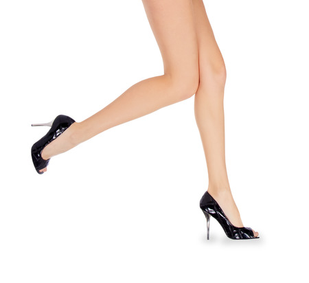 black sex: Long female legs in black shoes over white