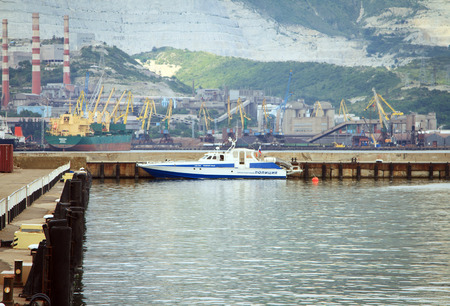 russian federation: Novorossiysk, Russian Federation, 04 July 2015: Boat traffic police moored to the pier on the waterfront Novorossiysk. Stock Photo