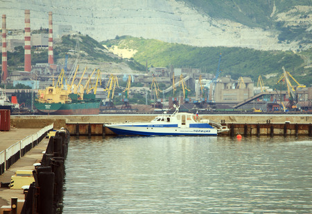 russian federation: Novorossiysk, Russian Federation, 04 July 2015: Boat traffic police moored to the pier on the waterfront Novorossiysk. Editorial