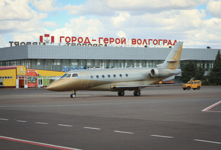 russian federation: Volgograd, Russian Federation, August 07,2015:  Airplane lending at the Airport terminal in Volgograd city.