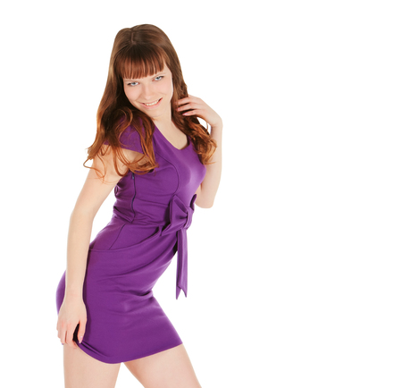 magentas: Fashion young brunette in magentas dress posing over white Stock Photo